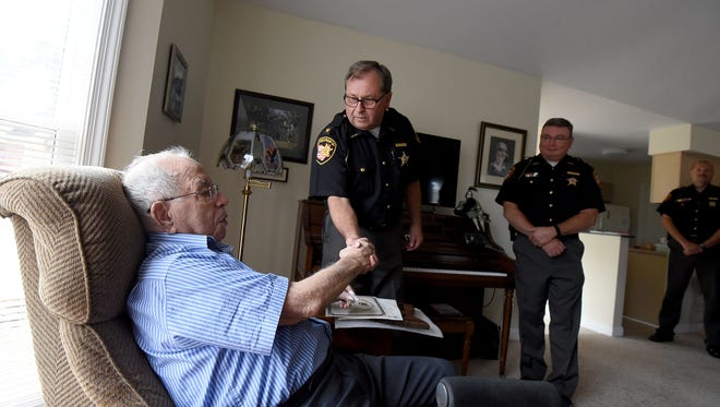Sheriff J. Steve Sheldon and about a half dozen of his deputies presented Art Hicks an Award of Valor in 2017 for his actions on Aug. 19, 1981, when he was shot by an accused murderer.