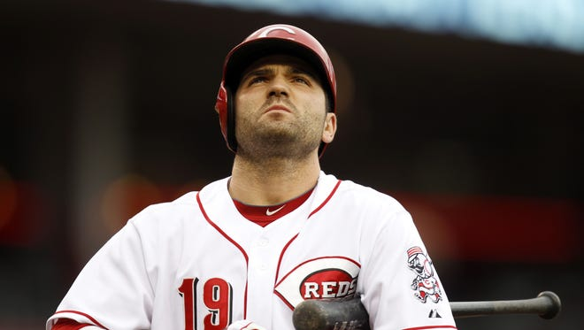 Reds first baseman Joey Votto looks toward the score board before his turn at bat against the San Diego Padres in the second game of a doubleheader at Great American Ball Park.