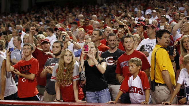 Reds fans cheer during a recent game.
