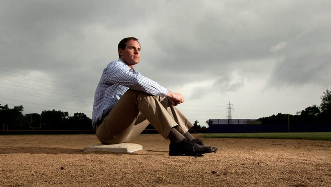 In this May 23, 2013, file photo, Garrett Broshuis poses for a photo at a baseball field in St. Louis. Broshuis is the driving force of a lawsuit against Major League Baseball, alleging violations of federal wage and overtime laws in a case some legal observers suggest has significant merit. (AP Photo/Jeff Roberson, File)