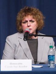 Judge Carol Sue Reader responds to a question posed