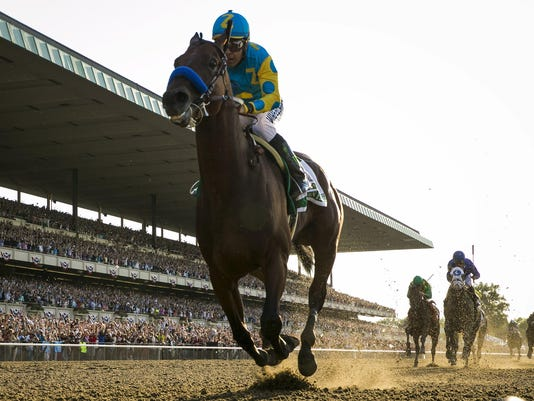 Espinoza, aboard American Pharoah, rides after winning the 147th running of the Belmont Stakes as well as the Triple Crown, in Elmont, New York