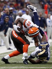 Cleveland Browns running back Duke Johnson Jr., left, is stopped by St. Louis Rams cornerback Trumaine Johnson during the first quarter of an NFL football game Sunday, Oct. 25, 2015, in St. Louis.