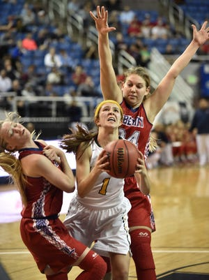 Bishop Manogue's Katie Turner shoots between Liberty's London Pavlica, left, and Gabby Doxtator in the second half of the 2016 NIAA Division State Basketball Championships at Lawlor Events Center on Feb. 25, 2016.