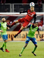 Toronto FC defender Justin Morrow (2) heads the ball