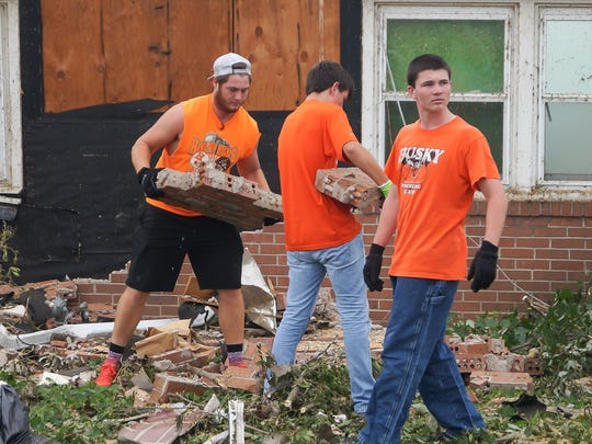 Left to right - Hamilton Heights football players Josh Feltz, Dylan Zachary and Bobby Williams helped out with cleanup in Kokomo following last week's tornadoes.