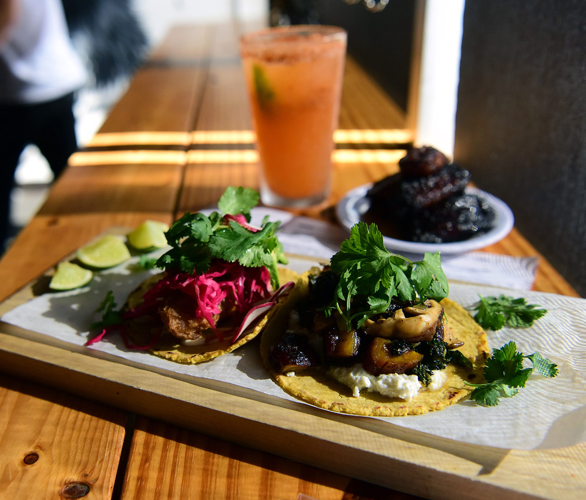At Black Rooster Taqueria, a variety of tacos, such as the Black Rooster asada (right) and the vegetarian, range from $3.25 to $4.75.