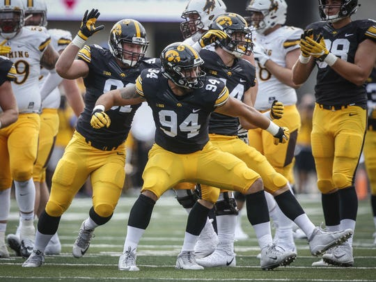 Iowa freshman defensive end A.J. Epenesa reacts after sacking Wyoming quarterback Josh Allen late in the second quarter at Kinnick Stadium in Iowa City on Saturday, Sept. 2, 2017.