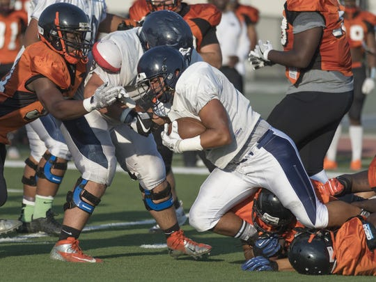 College of the Sequoias' Michael Ingram, a former Mt. Whitney standout, rushes against Reedley College in a scrimmage football game on Thursday, Aug. 25, 2016.