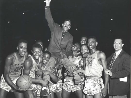 Crispus Attucks players celebrate winning the 1954