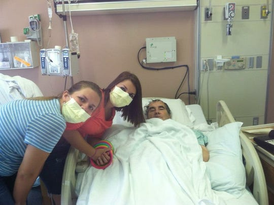 Archie Mitchell with (from left) granddaughters Mackenzie and Sierra Mitchell in July 2012. He spent 40 days in the hospital recovering from his heart transplant.