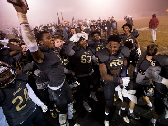Wetumpka players ceklebrate after beating Hillcrest