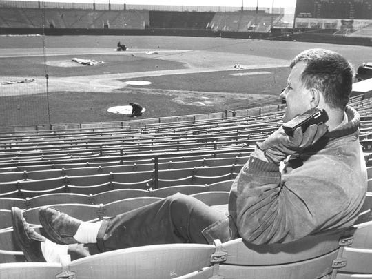 County Stadium employee Eugene Sabinash listens to a baseball game on his transistor radio while sitting in the grandstand on what was supposed to be the Milwaukee Braves' 1966 home opener on April 12, 1966. Amid battling court orders, the Braves played in Atlanta instead. This photo was published in the April 12, 1966, Milwaukee Journal.