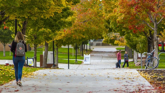 Southern Utah University students walk across campus, Thursday Oct. 22, 2015.
