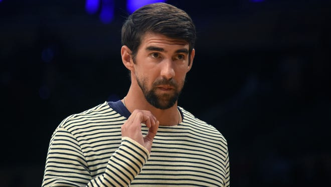 Michael Phelps hasn't gotten the urge to return to swimming. Not yet anyway.