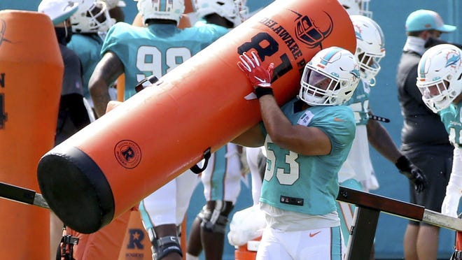 Dolphins linebacker Kyle Van Noy performs a drill at training camp Monday.,