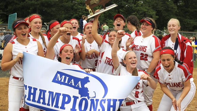 Bridgewater-Raynham Regional High School softball celebrates after becoming the Division 1 South Sectional Champions for the first time since 2014. The Trojans defeated Bishop-Feehan 4-0 at Taunton High on Sunday, June 17, 2019.