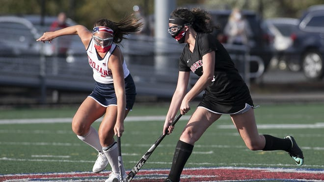 Bridgewater-Raynham Regional High School Captain Sara Spatola gets a stick on the ball to take possession from Brockton's Madison Becquart during the varsity field hockey game at Bridgewater-Raynham Regional High on Tuesday, Oct. 6, 2020.