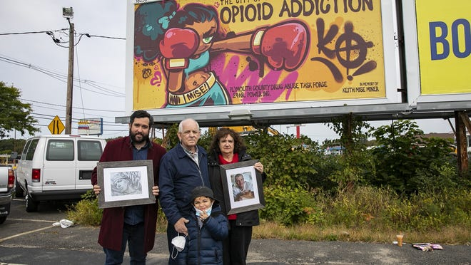 Keith Mise Miner's family brother Bryan Miner, step-father Joseph Tarlach, mother Linda Tarlach and nephew Joseph Tarlach, 5, of Groton attend the unveiling of a billboard fighting to end opiod addiction dedicated to their family member Keith Mise Miner at 2020 Main St. in Brockton on Tuesday, Sept. 22, 2020. The billboard promoting the fighting spirit of Brockton to fight addiction is designed by graffiti artist Merk Averil and dedicated in memory of 24 Hr Power Inc. graffiti artist Keith Mise who passed in August.