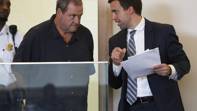 Ivan Keith, 61, formerly of Bridgewater confers with his attorney Jason Maloney during the arraignment at Taunton District Court on Wednesday, August 14, 2019.