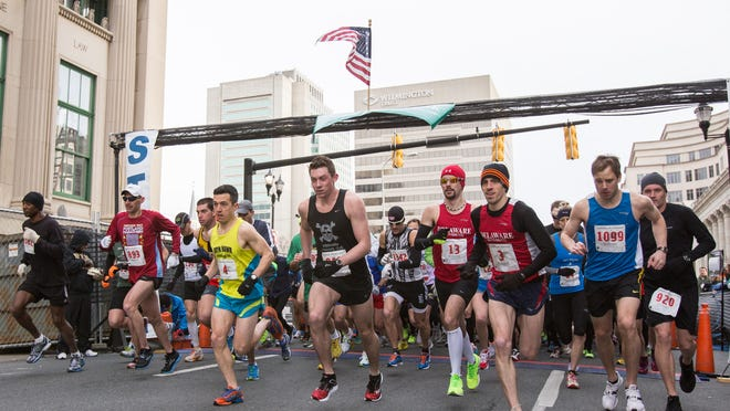 Runners take off from the start of the Caesar Rodney Half-Marathon in downtown Wilmington on Sunday, March 17, 2013.