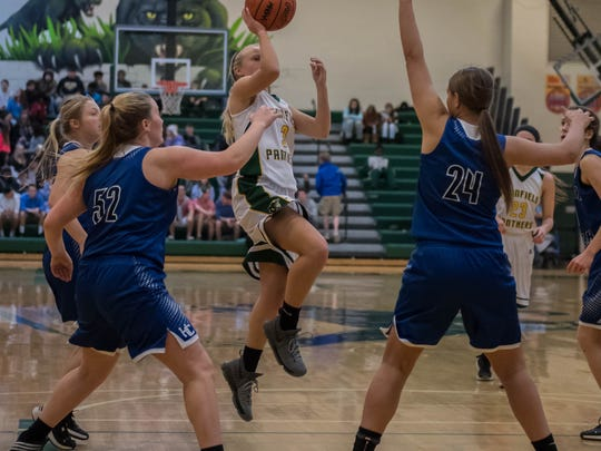 Pennfield's Naomi Davis (3) goes for the layup during