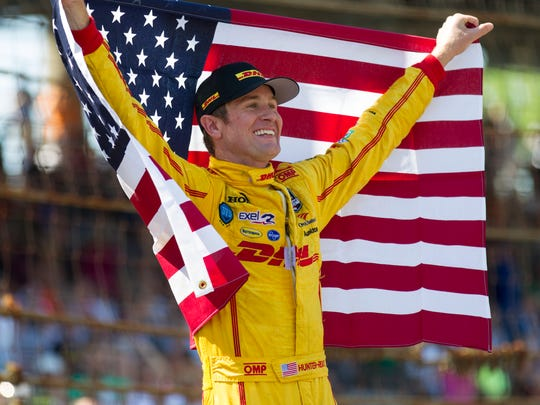Ryan Hunter-Reay celebrates after winning the 98th