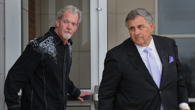 Colts owner Jim Irsay and attorney James Voyles leave the Hamilton County Sheriff's Office and Adult Detention center in Noblesville, March 17, 2014.