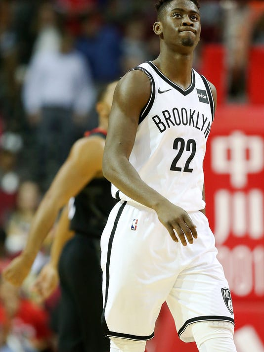 Brooklyn Nets guard Caris LeVert (22) looks up at the scoreboard at the end of the first quarter in an NBA basketball game against the Houston Rockets, Monday, Nov. 27, 2017, in Houston. (AP Photo/Eric Christian Smith)