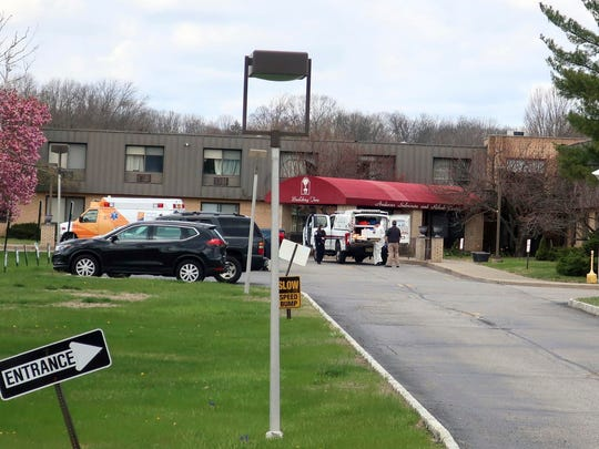 Ambulance crews are parked outside Andover Subacute and Rehabilitation Center in Andover, N.J., on April 16.