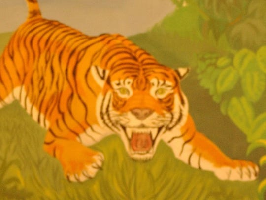 Painting of a Tiger inside St. Philip's Sheila Guerra Gymnasium.