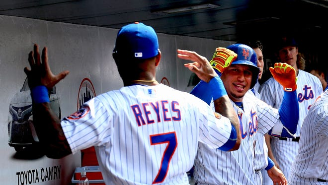 New York Mets pinch hitter Asdrubal Cabrera (13) reacts with shortstop Jose Reyes (7) after hitting the game winning two run home run against the Arizona Diamondbacks during the seventh inning at Citi Field.