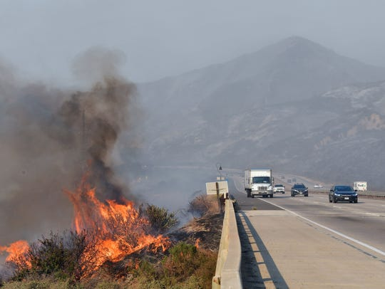 Fire burns beside the US 101 freeway, southbound, near
