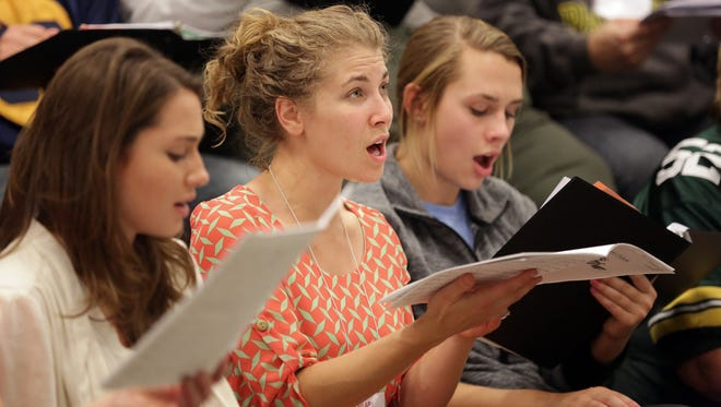 Hilary Haskell (center) rehearses with newVoices at Appleton Alliance Church in Appleton, Wis., Sunday, October 11, 2015.Ron Page/Post-Crescent Media