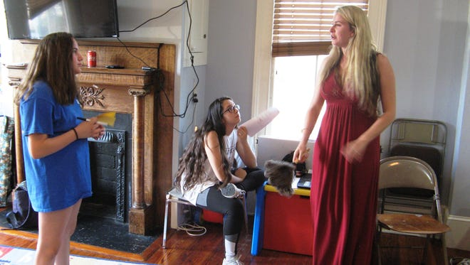 Bianca Montague gives a cast member direction as Melanie Bynum looks on