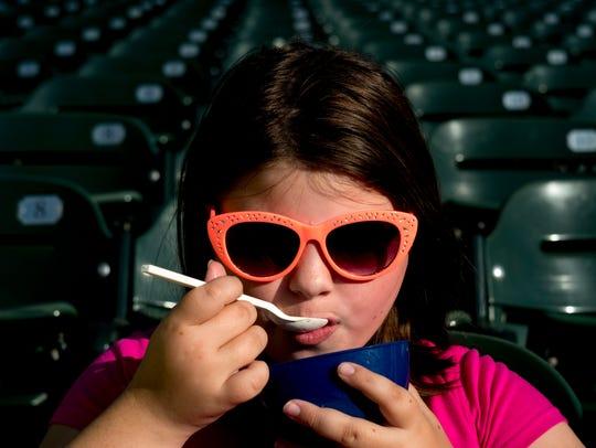 Makayla Graham, 9, of Clinton, enjoys an ice cream