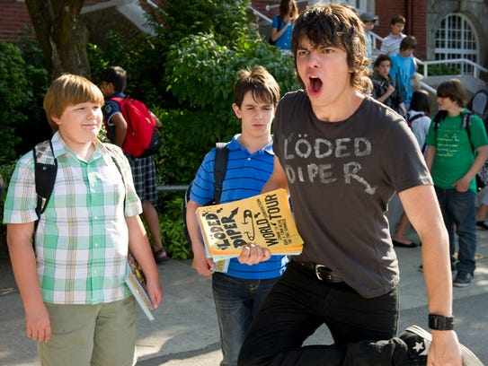 Devon Bostick (front right) played Rodrick in three