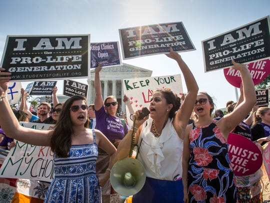 Reagan Barklage of St. Louis, center, and other anti-abortion