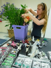 New Mexico State University floriculture program coordinator Sabine Green sets up a floral design practice session for her students on Thursday, July 27, 2017, at Skeen Hall on campus.