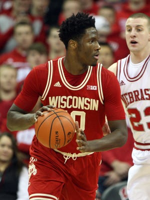 Wisconsin Badgers forward Nigel Hayes (10) looks to pass as Nebraska Cornhuskers forward Nick Fuller (23) defends during the first half at the Kohl Center.