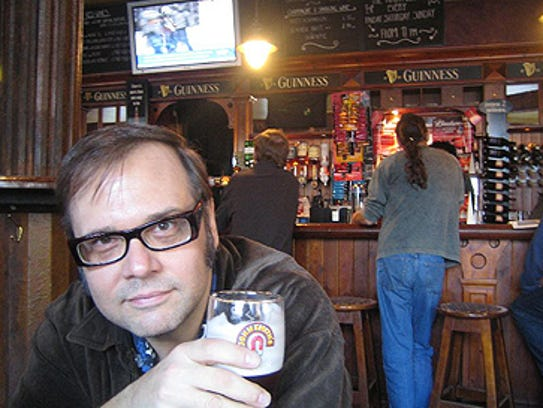 Dennis Diken of the Smithereens enjoys a cold one.