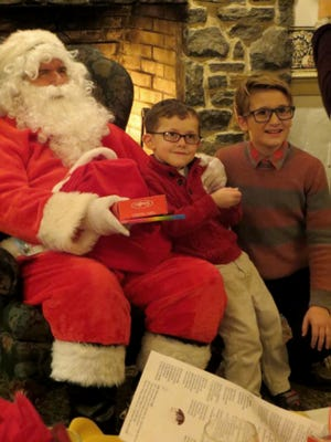 Children receive gifts from Santa Claus, during the Gettysburg Lions Club's Christmas party.