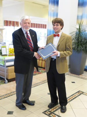 Gettysburg Lion Bob Almquist, left, presents Gettysburg High School senior Seth Zimman, right, with the student of the month award for March.