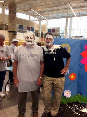 Lebanon County commissioners Bill Ames, left, and Bob Phillips pose for a photo after being 'pied' in the face with whipped cream pies at the 20th annual United Way Day of Caring breakfast held recently at Lebanon High School.