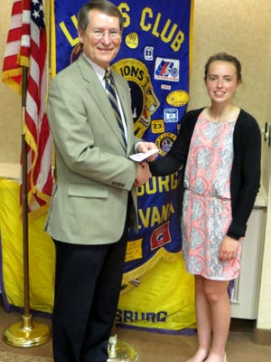 Gettysburg Lions Club President Bob Teeter, left, welcomes Kimberly Grasmick to the Lions Club meeting.