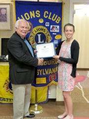 Gettysburg Lions Club President Bob Berkey, left, presents