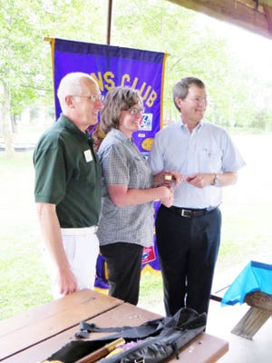 Gettysburg Lions president Bob Teeter, right, is shown exchanging the gavel with incoming president Maggie Baldwin, center, after taking the oath of the office as president of the Gettysburg Lions Club. First Vice District Governor Dennis Cope is shown, at left.