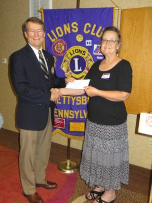 Bob Teeter, left, welcomes Vickie Corbett to the Gettysburg Lions Club meeting. Corbett is the executive director of the Adams County United Way.