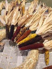 Fall wreath made out of small Indian corn.