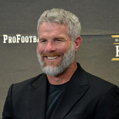 Brett Favre looks on during a press conference to announce